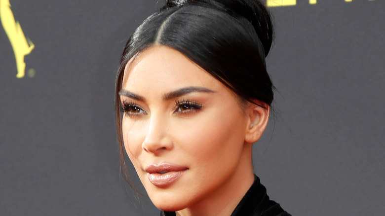 Kim Kardashian wearing a black evening dress