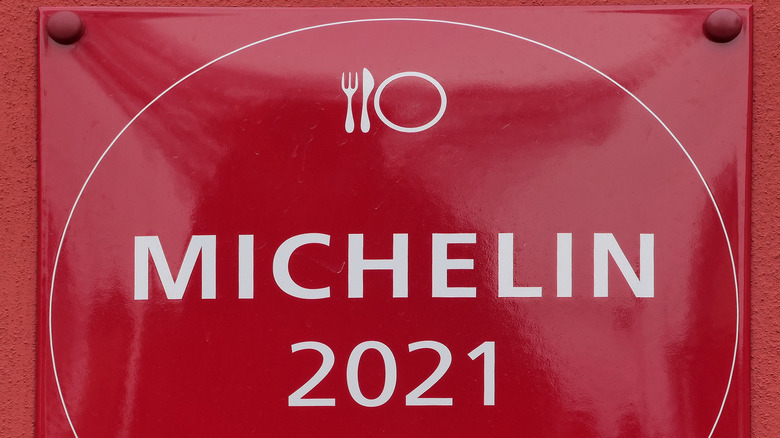 """Red sign reading """"Michelin 2021"""""""