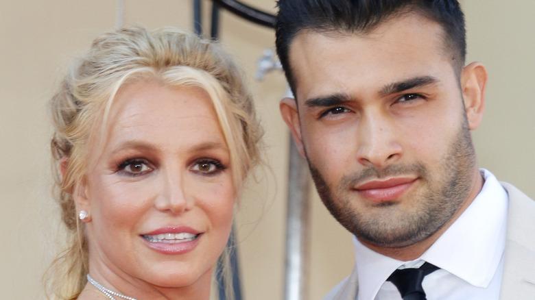 Sam Asghari and Britney Spears smiling