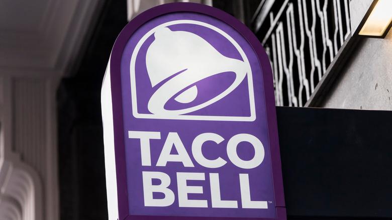 Taco Bell sign on outside of restaurant