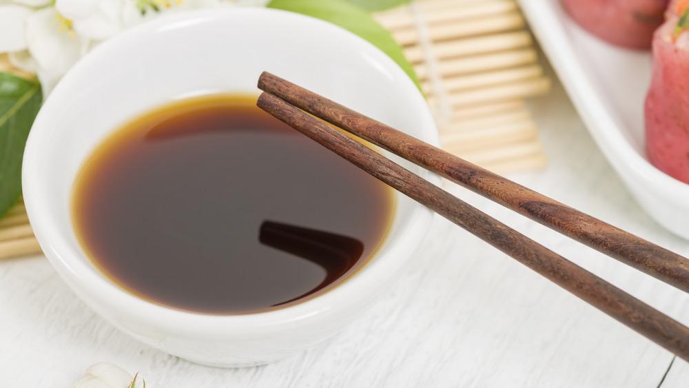 Bowl of hoisin sauce and chopsticks