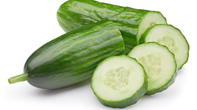 Cucumber cut in half and slices of cucumber