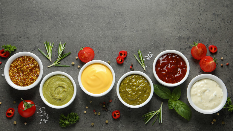 Several condiments in tiny bowls