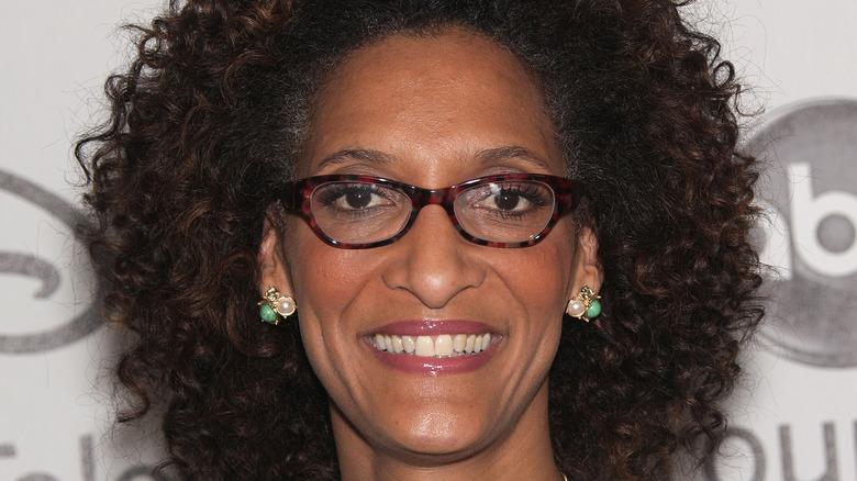 Carla Hall smiles in glasses
