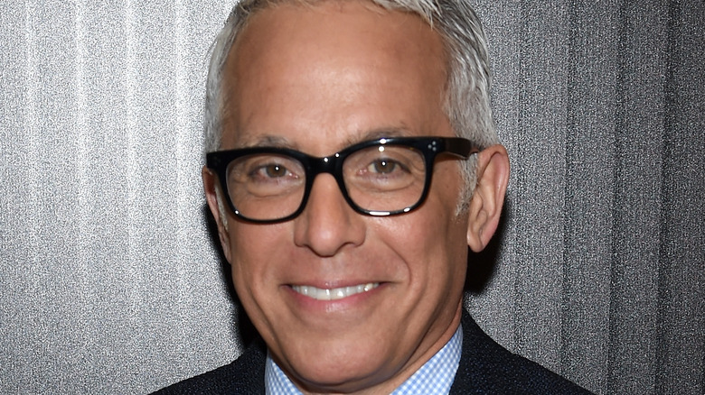 Geoffrey Zakarian smiling with glasses on