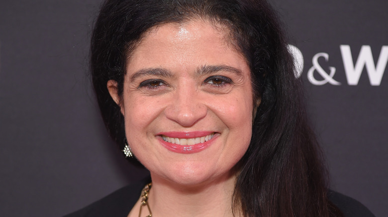 Alex Guarnaschelli smiles with pink lipgloss