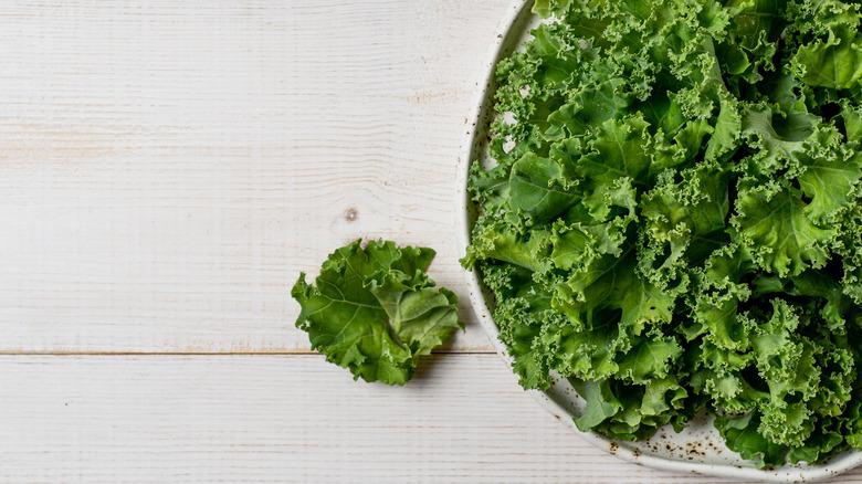 Kale on wood background