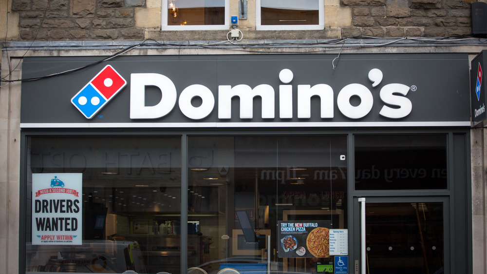 Domino's pizza and man with dog
