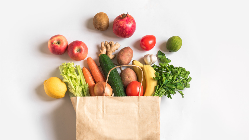 Groceries in a bag on a white background