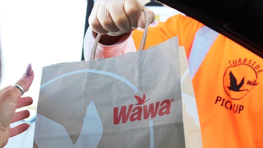 Wawa employee handing over food bag