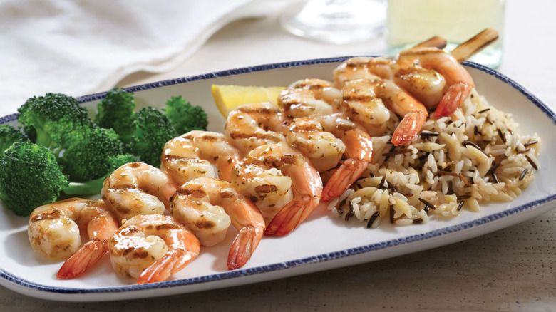 Shrimp on skewer with rice