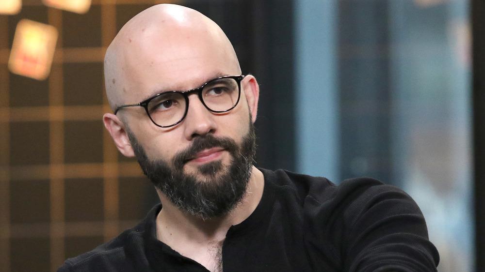 Andrew Rea in black glasses