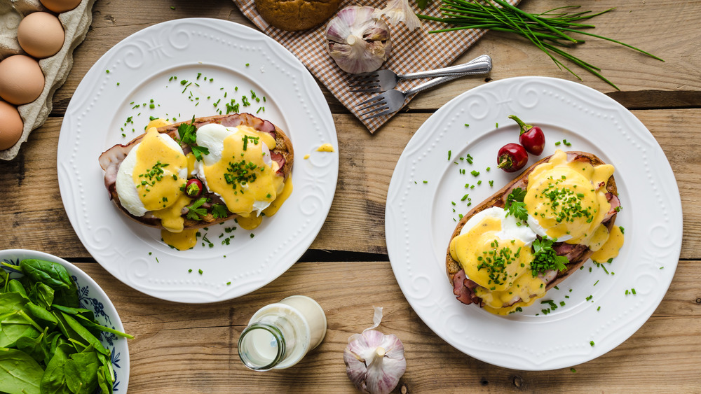 Plates of eggs Benedict