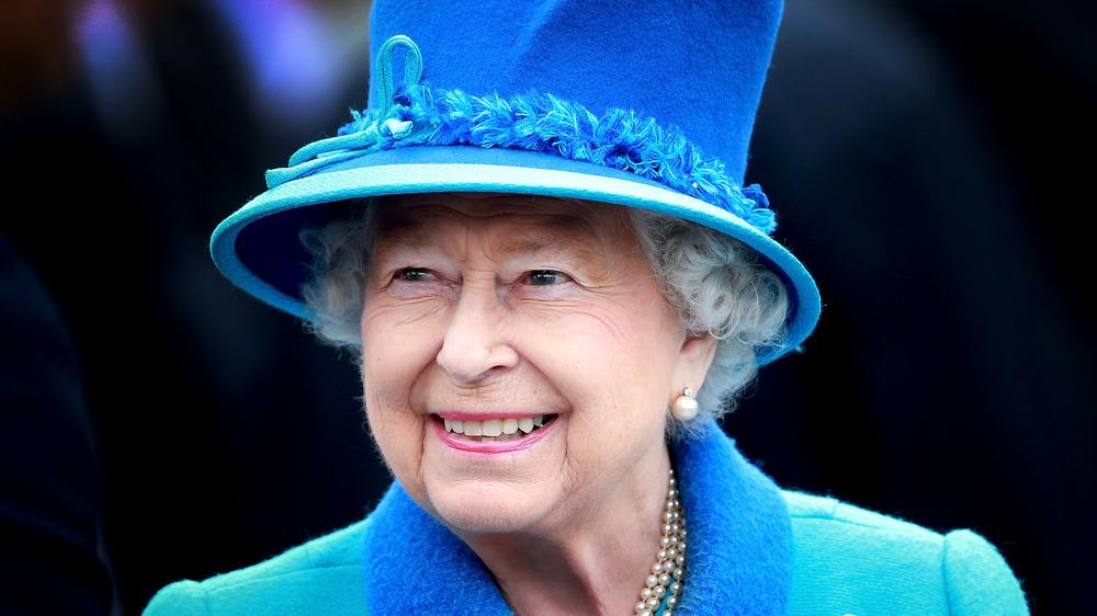 Queen Elizabeth II in blue hat