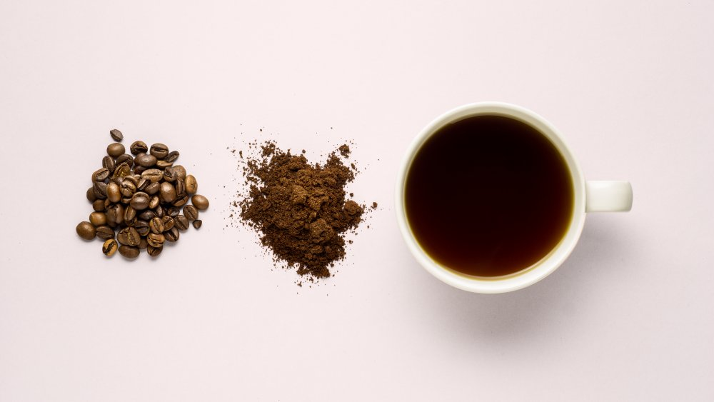 coffee beans, instant coffee crystals, cup of coffee white background