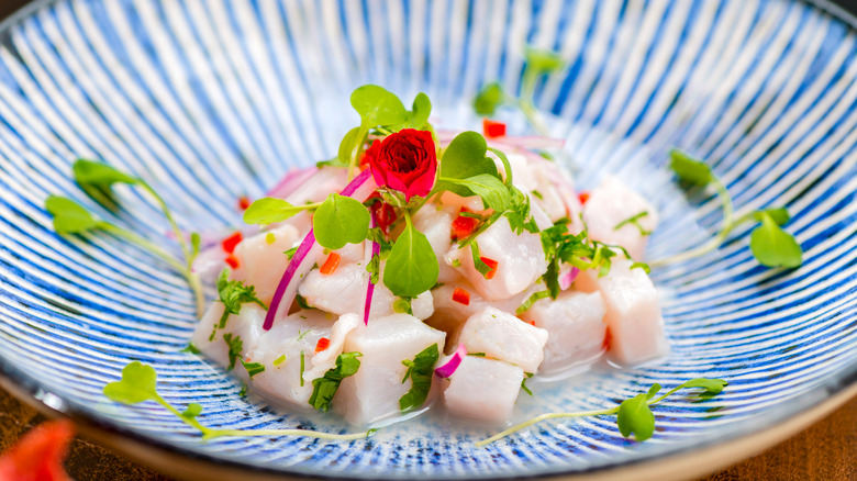 Ceviche in blue bowl with watercress