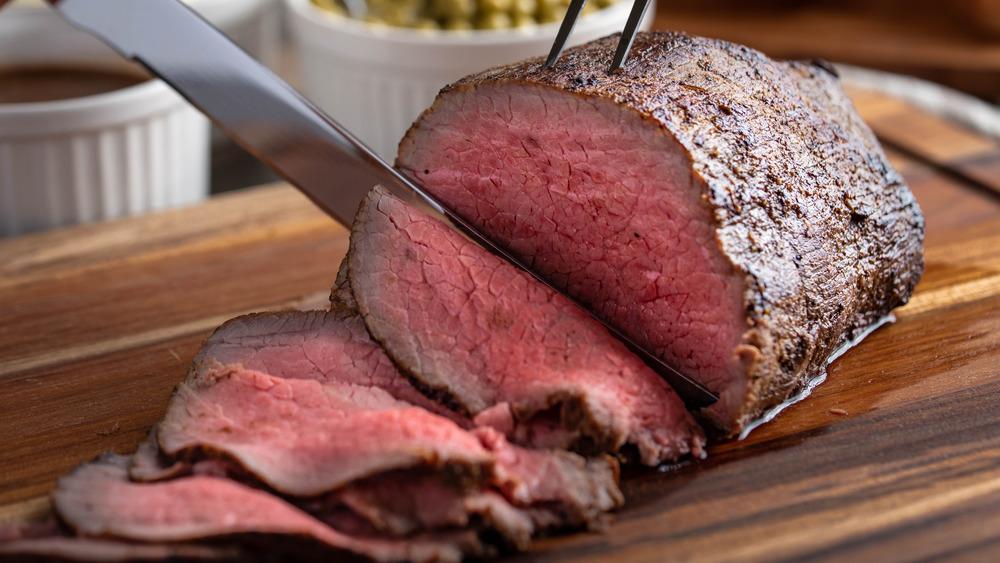 Eye of round steak being sliced