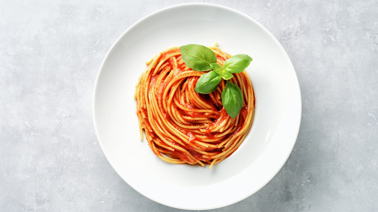 Tomato sauce and pasta in a bowl