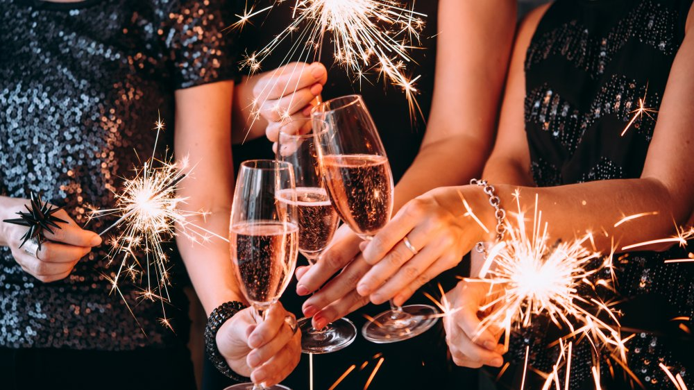 People toast with sparkling wine