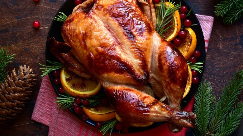 Roast chicken on platter with garnish
