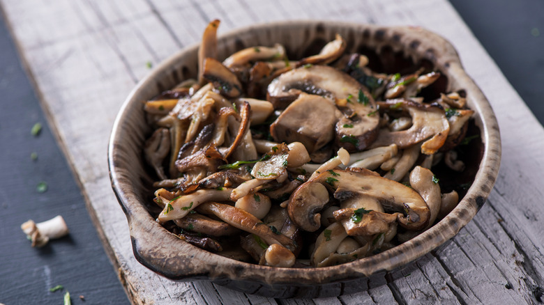 A bowl of cooked mushrooms