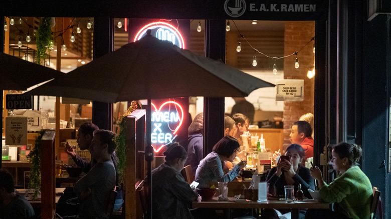 nighttime outdoor restaurant scene in New York City