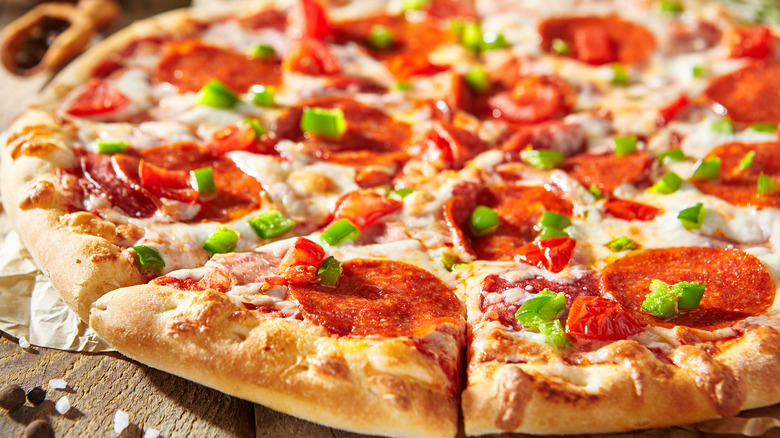 Pizza topped with pepperoni and pepper
