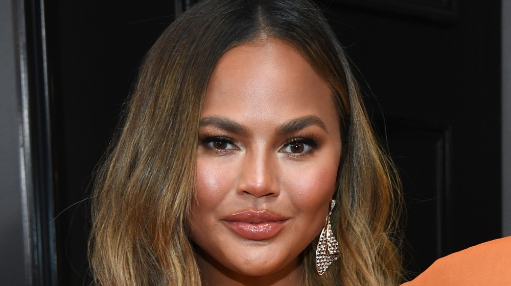 Chrissy Teigen with sparkly earrings