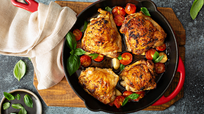 Chicken thighs in pan