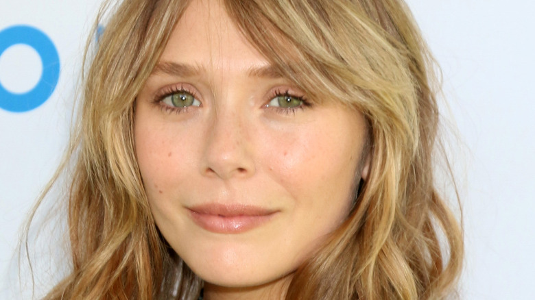Headshot of Elizabeth Olsen on red carpet