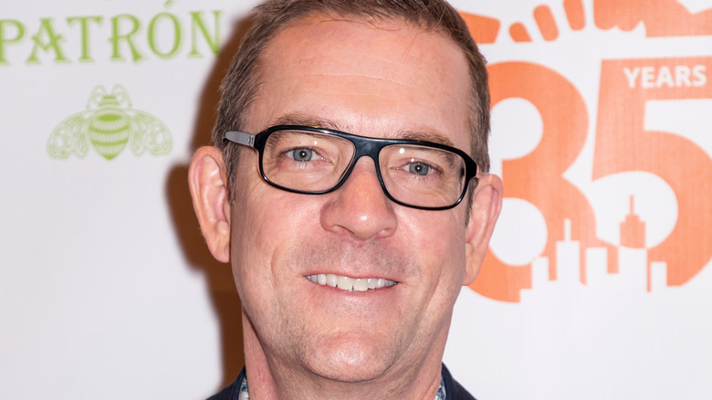 Ted Allen smiling and posing at an event