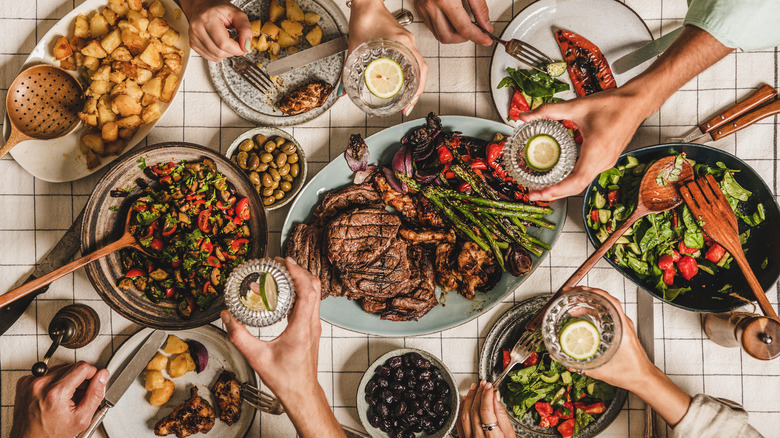 Dishes of food spread across table