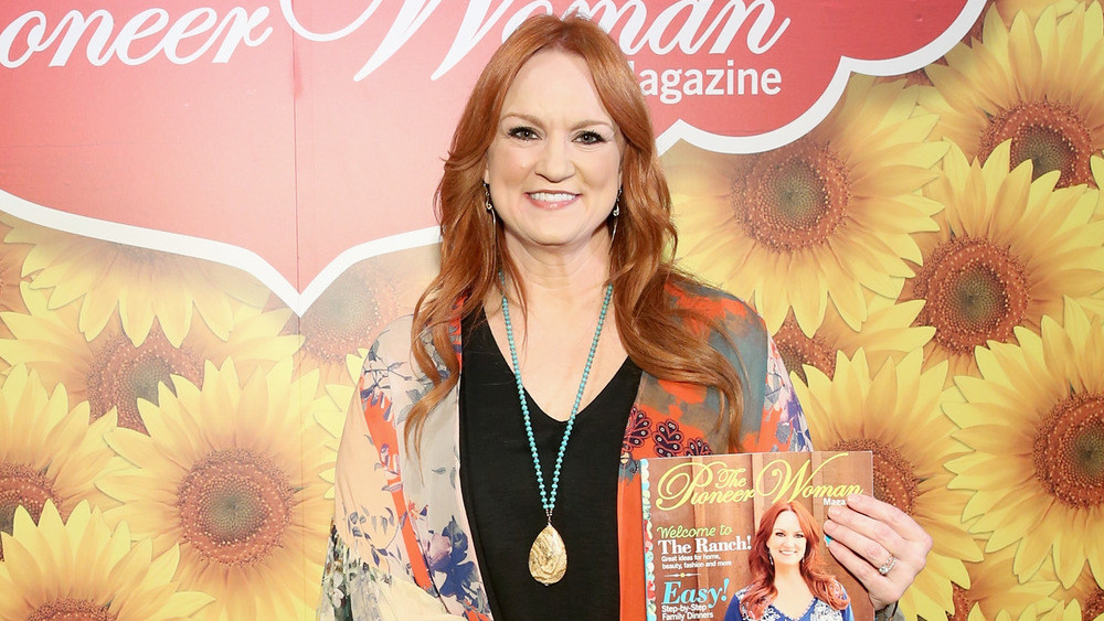 Ree Drummond holding a copy of her magazine