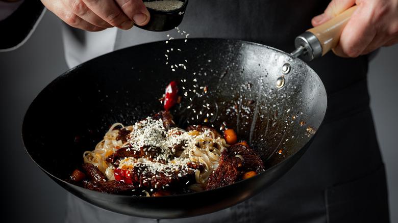 Cooking food in wok