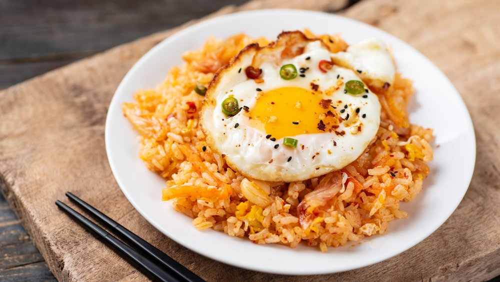 fried rice with an egg on top
