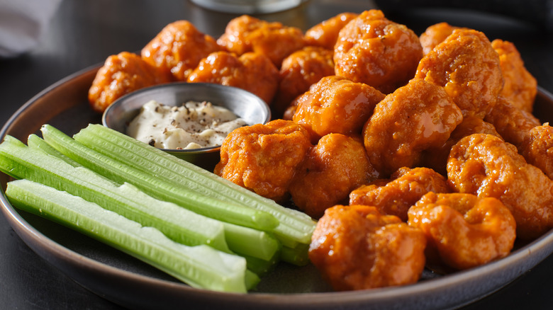 Buffalo wings on plate with celery and dip