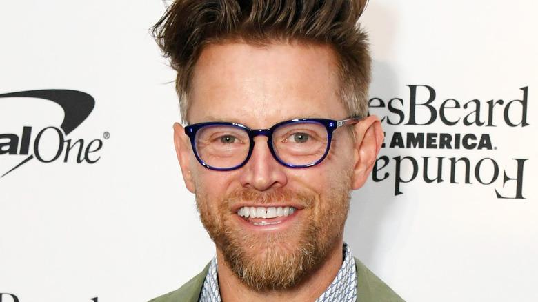Richard Blais smiling with glasses