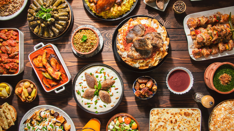 Middle Eastern food spread on wooden table