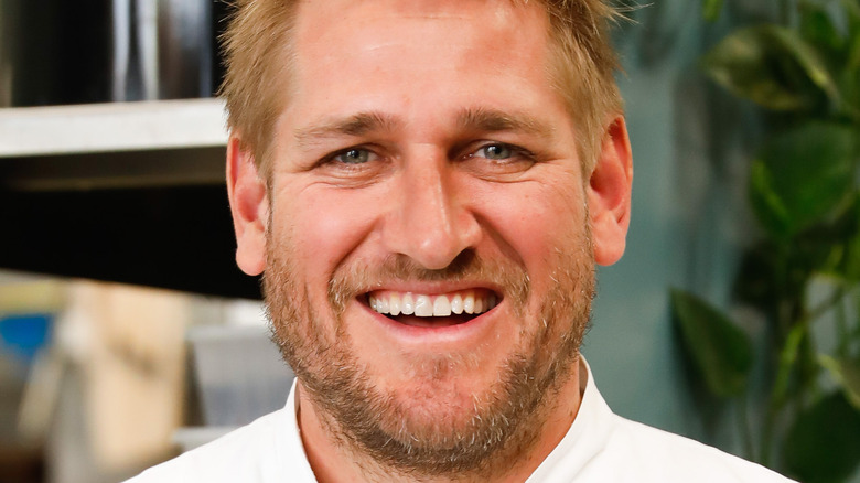 Curtis Stone grinning widely