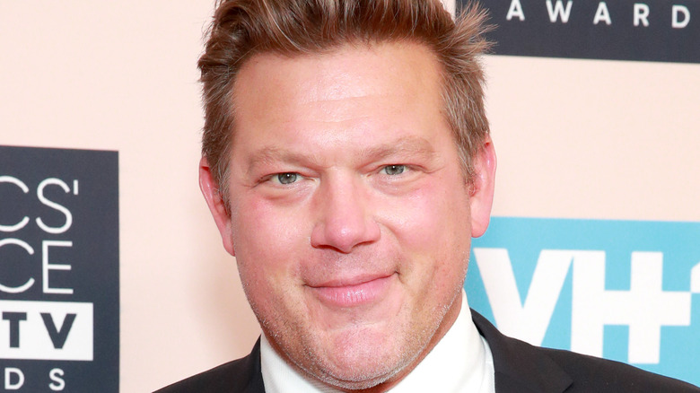Tyler Florence wearing a suit on white background
