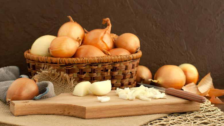 Chopped white onions on a cutting board