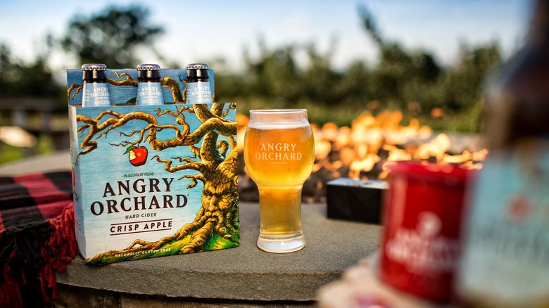 Angry Orchard cider on patio table