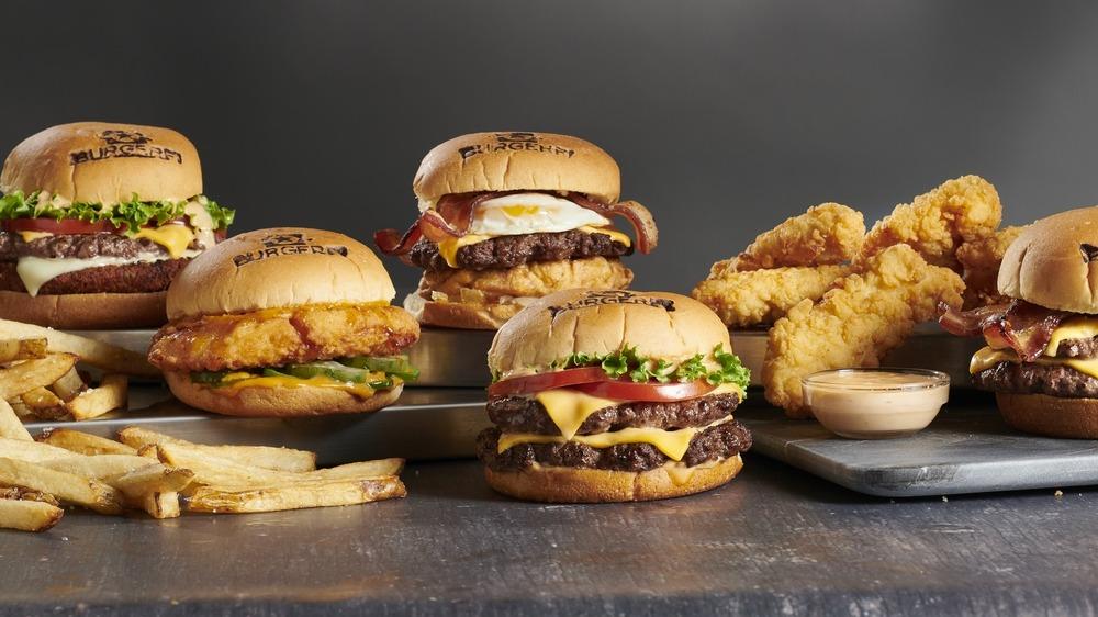 Four BurgerFi burgers and fries