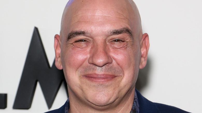 Michael Symon smiling on red carpet