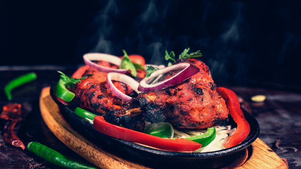 Tandoori chicken on a wooden platter