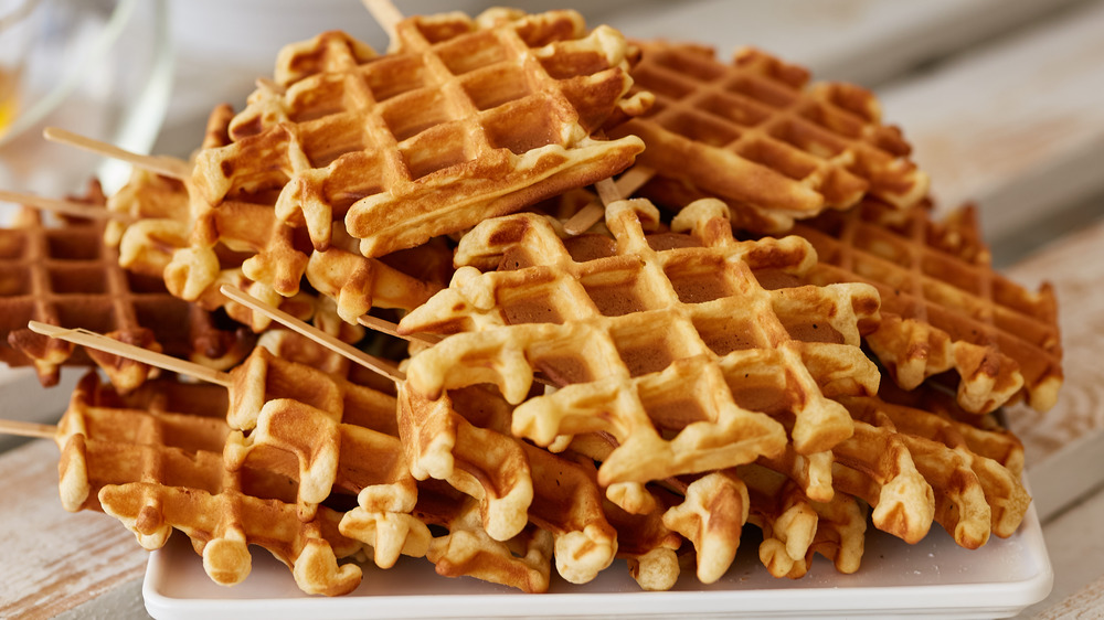 Waffles on sticks on a plate
