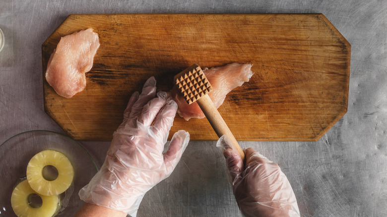 tenderizing chicken with mallet
