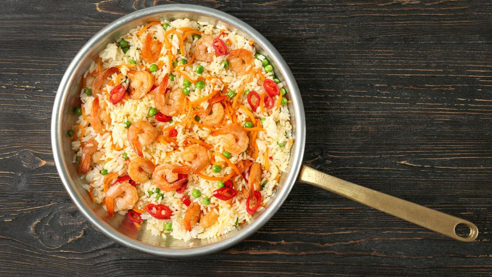 Well-cooked shrimp on fried rice.