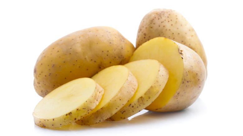 sliced and whole potatoes