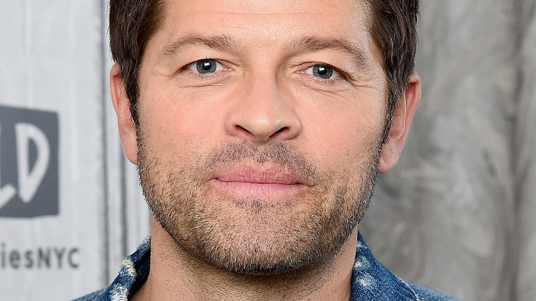 Misha Collins posing at an event